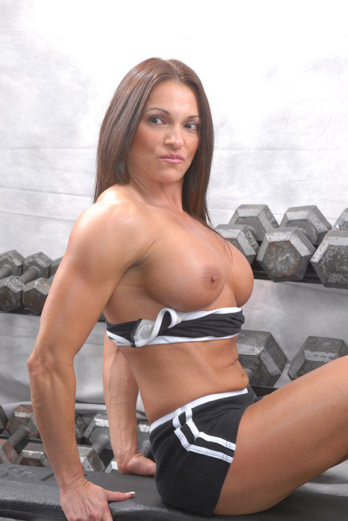 Horny female bodybuilder Kristine demonstrates her nude tits