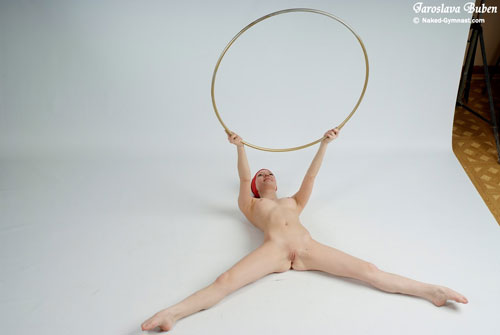 W-l lying nude exercises with a hula-hoop