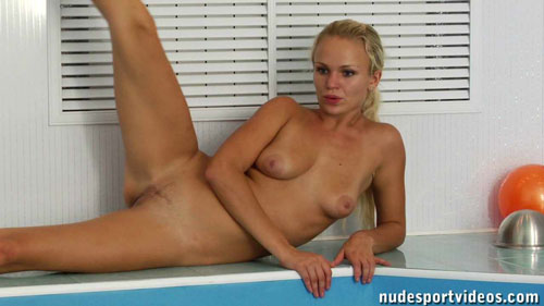 Side-lying nude exercising poolside