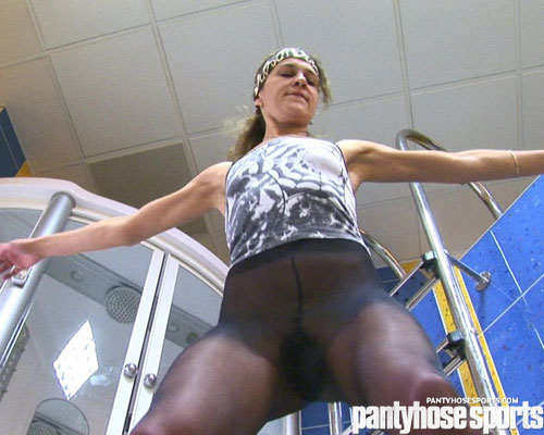 Pantyhose sports girl trains her nylon legs and arms