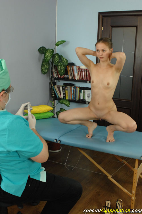 Shooting a squatted nude sports babe at a medical fetish exam